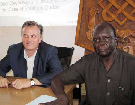 The Forum's director for Africa, Shawn Houlihan, poses with the president of the University of Juba, Dr. Sibrino Forojalla.