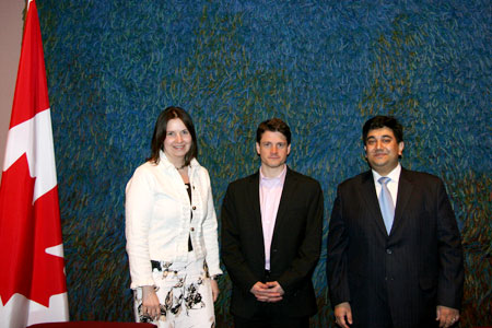 Alison Clement, Senior Advisor with the Department of Foreign Affairs and International Trade Canada (DFAIT)(left)  and Denis Stevens (middle), Director  General, Intergovernmental Relations and Public Outreach, DFAIT, pose with the Forum's senior director of Global Programs, Rupak Chattopadhyay, after a presentation on the Forum and its work on diversity at DFAIT offices in Ottawa.