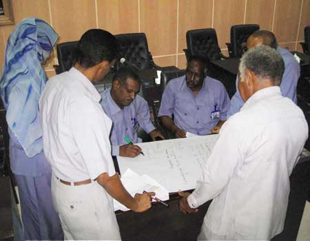 Fiscal training participants discuss central objectives of fiscal federalism in Sudan in small group break-out session.