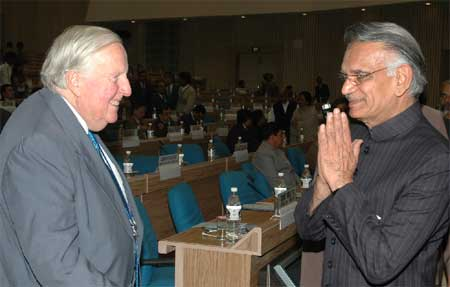 Photo: At the pre-conference in New Delhi before the 4th International Conference on Federalism, India's Home Minister Shri Shivraj Patil greets Professor Ronald Watts of Queen's University, Canada, one of the founders of the Forum of Federations.
