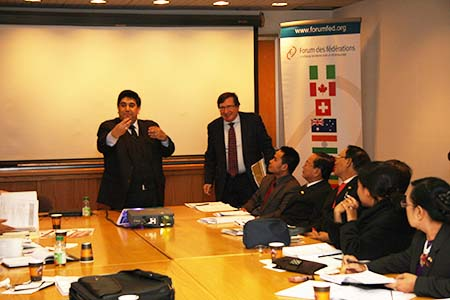 (left-right) The President of the Forum, Mr. Rupak Chattopadhyay and Mr. Pietro Merlo, Senior Advisor to Forum speaks to the Burmese Parliamentarian delegation on April 22, 2013.