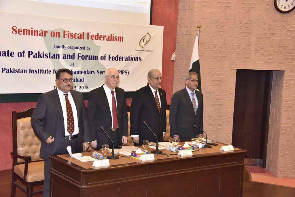 Chairman Senate, Mian Raza Rabbani and others address guests at the seminar