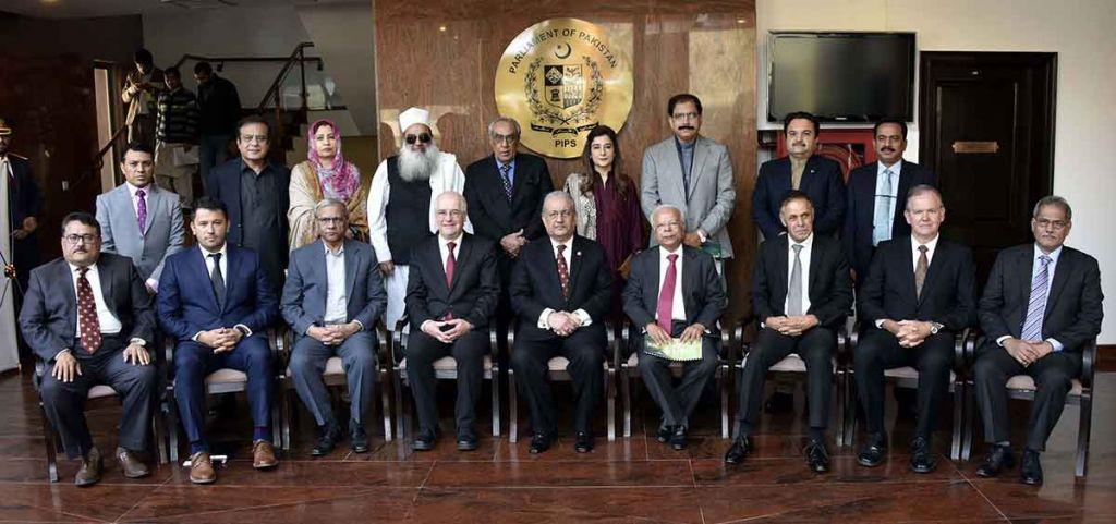 Chairman Senate, Mian Raza Rabbani with participants of the seminar.